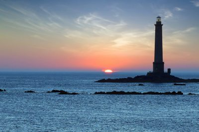 Landscape with Lighthouse during sunset. Brittany, France.